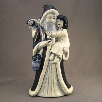 H140 Santa & Girl figurine
