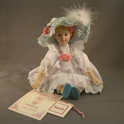 Sarah (china doll, moveable limbs, fabric and feather clothing)