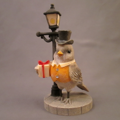 Impeckable Taste - robin & lamppost figure