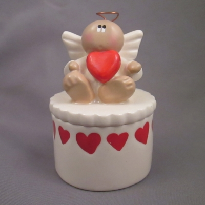 Angel with red blank heart on white box