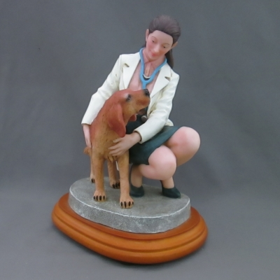 Loyal Companion (female veterinarian and dog)