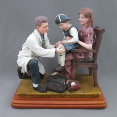 Scrapes and Slide (male doctor with boy and mother)